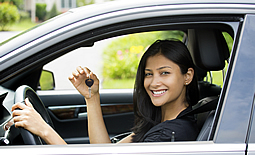 Young lady shows off new car keys
